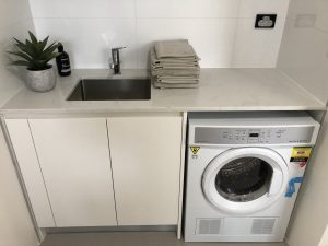 Create Your Dream Laundry With A Stone Benchtop